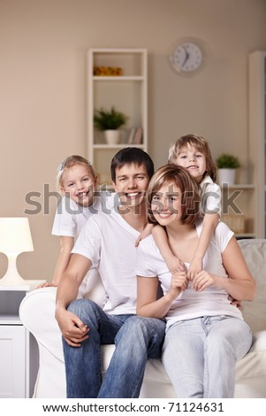 Young families with children at home in the evening - stock photo