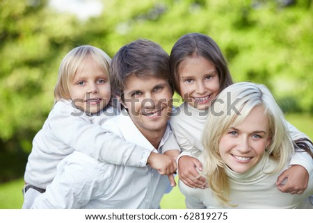 Young families with children outdoors - stock photo