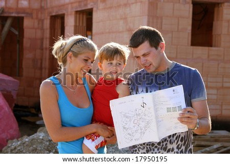 young familiy building a home - stock photo