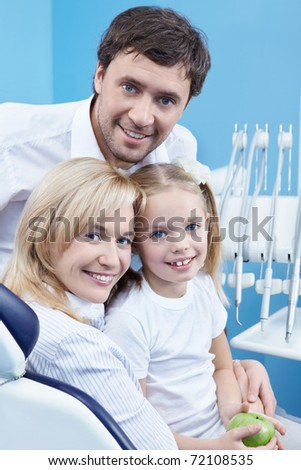 Young family at a reception at the dentist