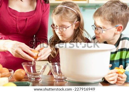 Young family baking in the kitchen - stock photo
