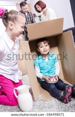 young family by packing for moving into a new home
