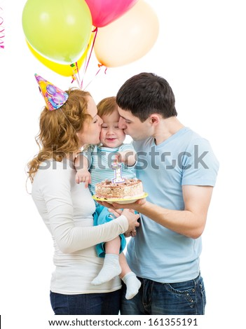 young family celebrating first baby birthday - stock photo