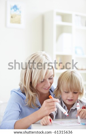 Young family draws - stock photo