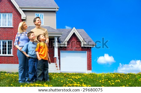 Young family dreaming about a new home.  Real estate concept - stock photo
