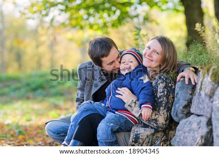 Young family enjoying beautiful autumn day