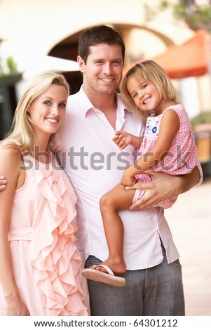 Young Family Enjoying Shopping Trip Together - stock photo