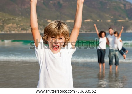 Young Family Enjoying the a stroll on the beach - stock photo