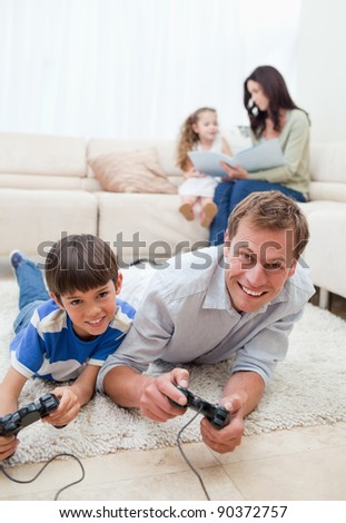 Young family enjoys spending their spare time together - stock photo