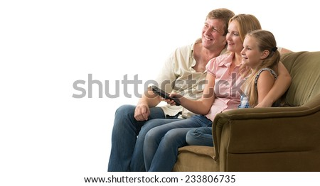 Young family: father, mother and daughter watching television sitting on the couch. All of them are very emotional. Isolated on white. - stock photo