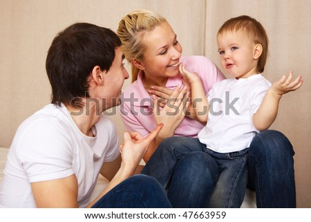 young family having good time together at home - stock photo