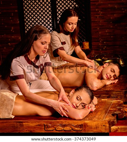 Young family having oil Ayurveda spa treatment in honeymoon. - stock photo