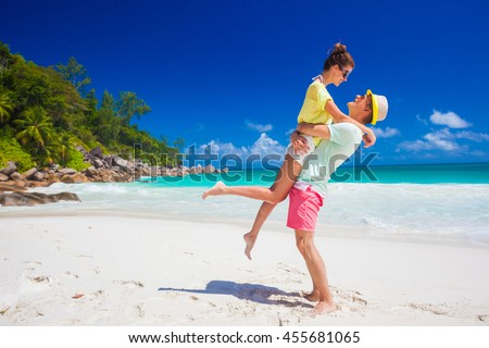young family in love having fun at tropical Anse Goergette beach. Praslin, Seychelles