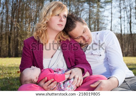 Young family is having  nice time with their baby on a sunny day - stock photo