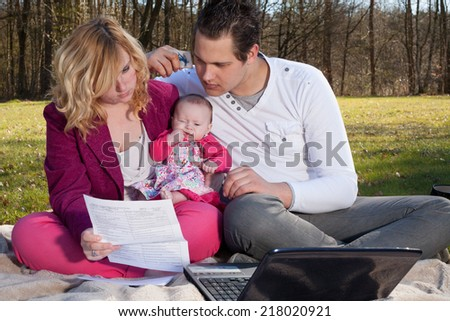 Young family is having some financial issues to paying the invoices - stock photo