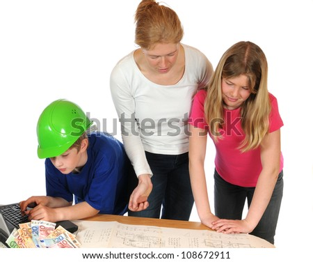 Young family is planning their own house, blueprint released - stock photo