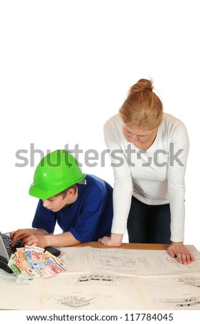Young family is planning their own house Note for inspector: Plan is from my own house, see PR - stock photo