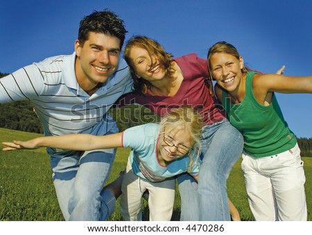Young family is playing around on a sunny day. keyword for this collection is family7 - stock photo