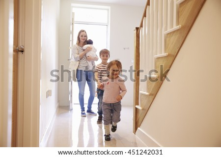 Young Family Looking Around Property For Sale - stock photo
