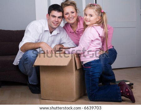 young family moving house, real estate concept - stock photo
