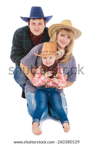 Young family of three persons in the stylish American cowboy costumes - isolated on white. - stock photo