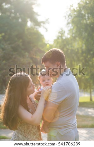 young family on a walk in the park