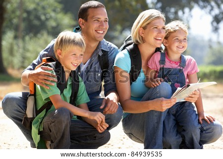 Young family on country walk - stock photo