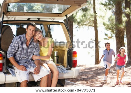 Young family on day out in country - stock photo