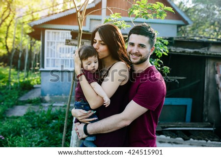 young family on the nature in the countryside - stock photo