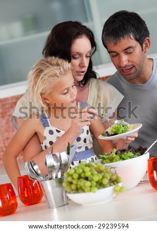 Young Family perparing food in the kitchen - stock photo