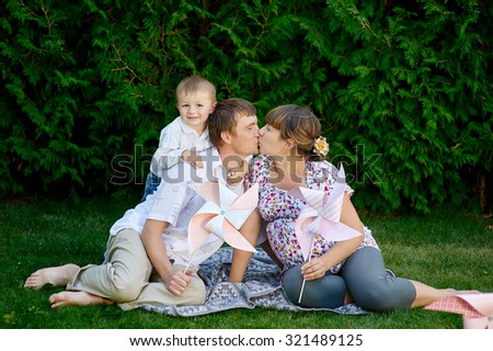 Young family playing at a picnic in the park.