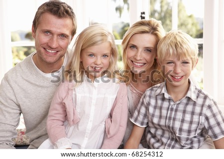 Young family pose together - stock photo