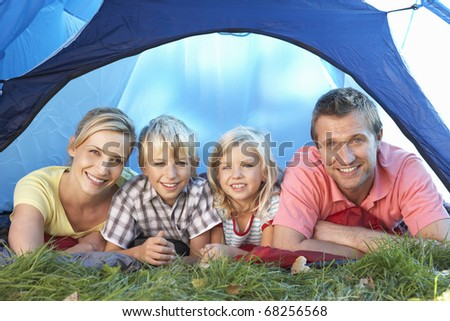 Young family poses in tent - stock photo
