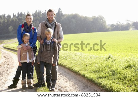 Young family posing in park - stock photo