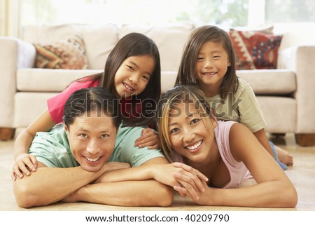 Young Family Relaxing At Home - stock photo