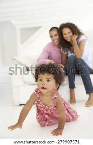 YOung Family Relaxing On Sofa - stock photo