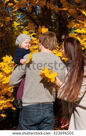Young family relaxing outdoors In autumn park - stock photo