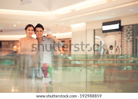 Young family shopping in the mall - stock photo