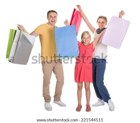 Young Family Shopping Together. Isolated On White - stock photo