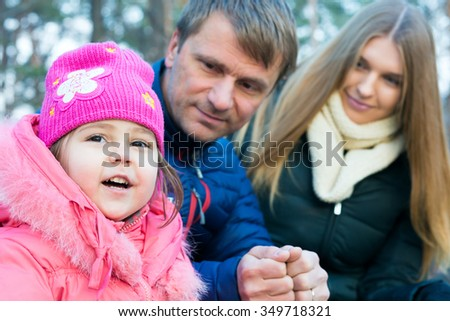 Young Family smart Father beautiful Mother little Baby Daughter together smiling outdoor Portrait - stock photo