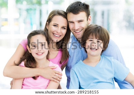 Young family smiling - stock photo