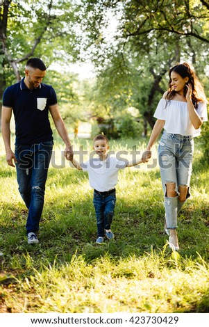 Young family spending holiday in park - stock photo