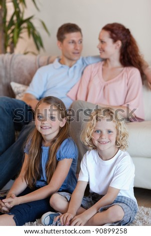 Young family spending time in front of the tv