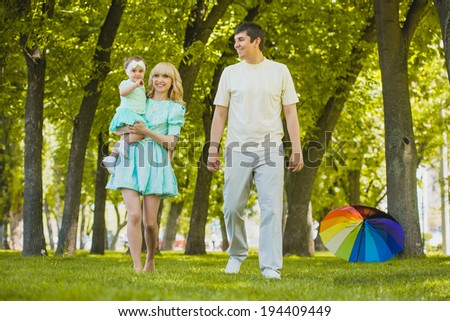 young family spending time outdoor on a summer day - stock photo