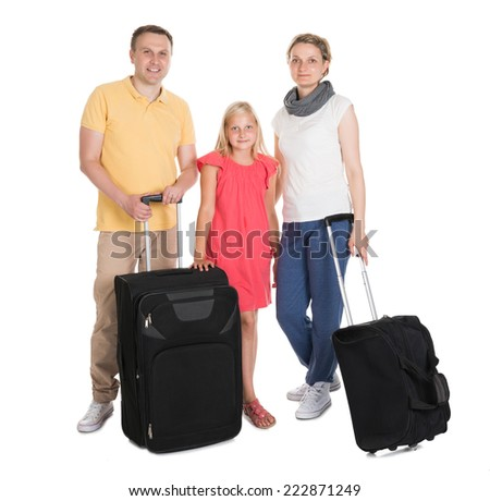 Young Family Standing With Luggage. Isolated On White