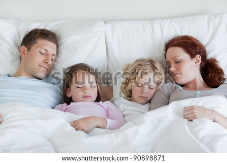 Young family taking a nap together