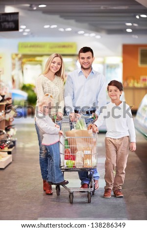 Young family with a cart in the store