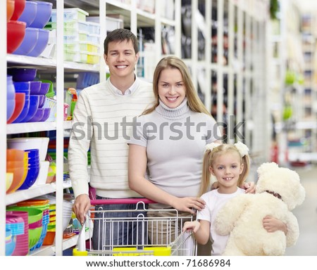 Young family with a child in a store - stock photo
