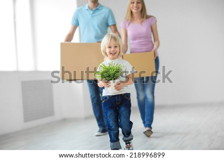 Young family with a child move - stock photo