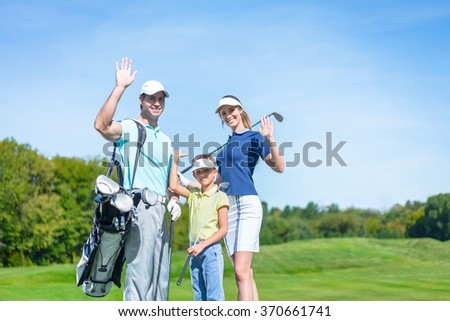 Young family with a golf bag outdoors